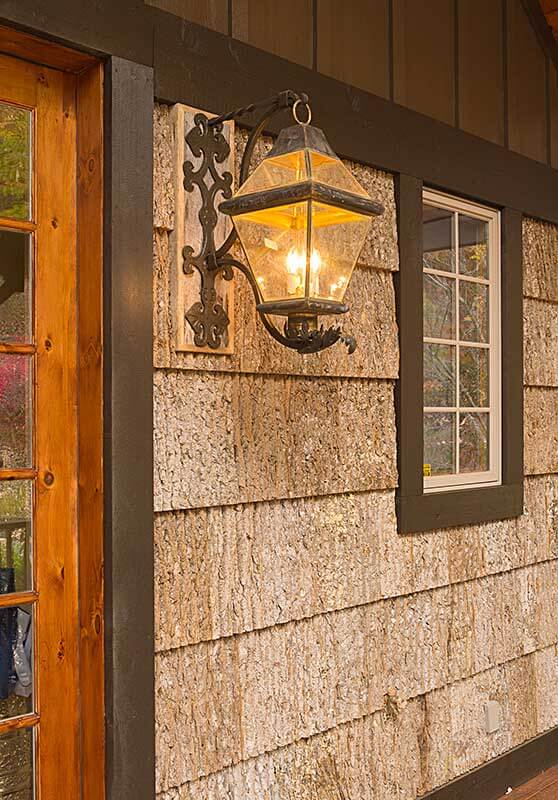 stately-mtn-cottage-door-light-sineath-v