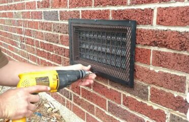 checking outside vents with drill